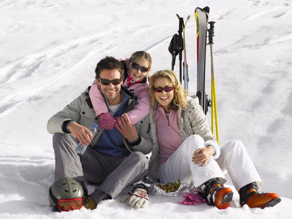 Stock Photo: 1888R-41142 Young Family On Ski Vacation