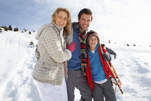 Young Family On Winter Vacation : Stock Photo