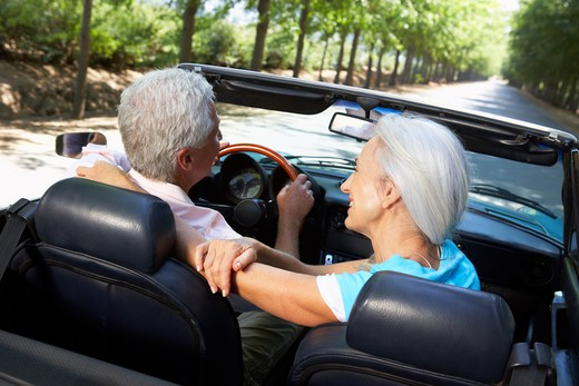 Senior couple in sports car : Stock Photo