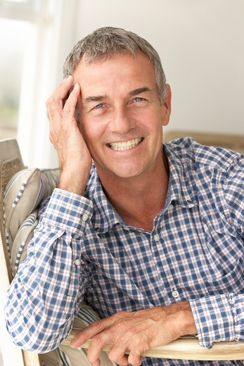 Stock Photo: 1888R-42214 Mid age man at home