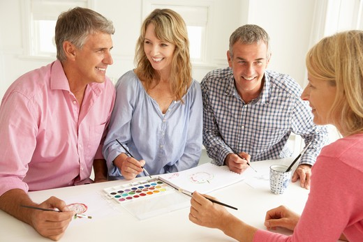 Mid age couples painting with watercolors : Stock Photo