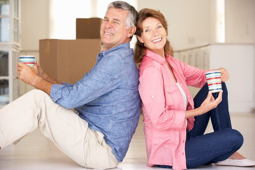 Senior couple in new home : Stock Photo