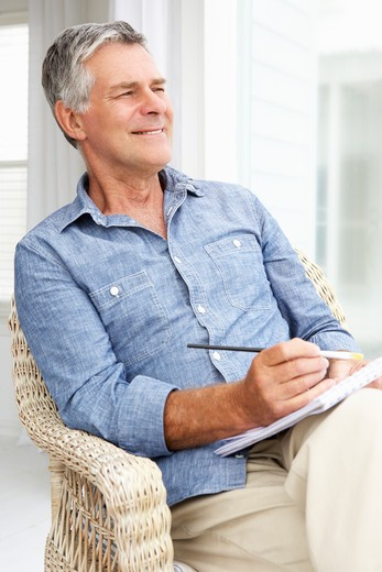 Senior man sketching : Stock Photo