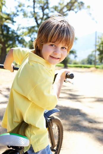 Little boy on country bike ride : Stock Photo