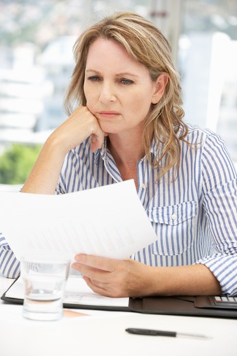 Stock Photo: 1888R-42731 Worried businesswoman