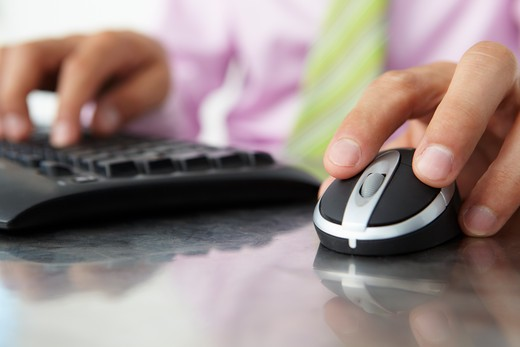 Close up man using  keyboard and mouse : Stock Photo