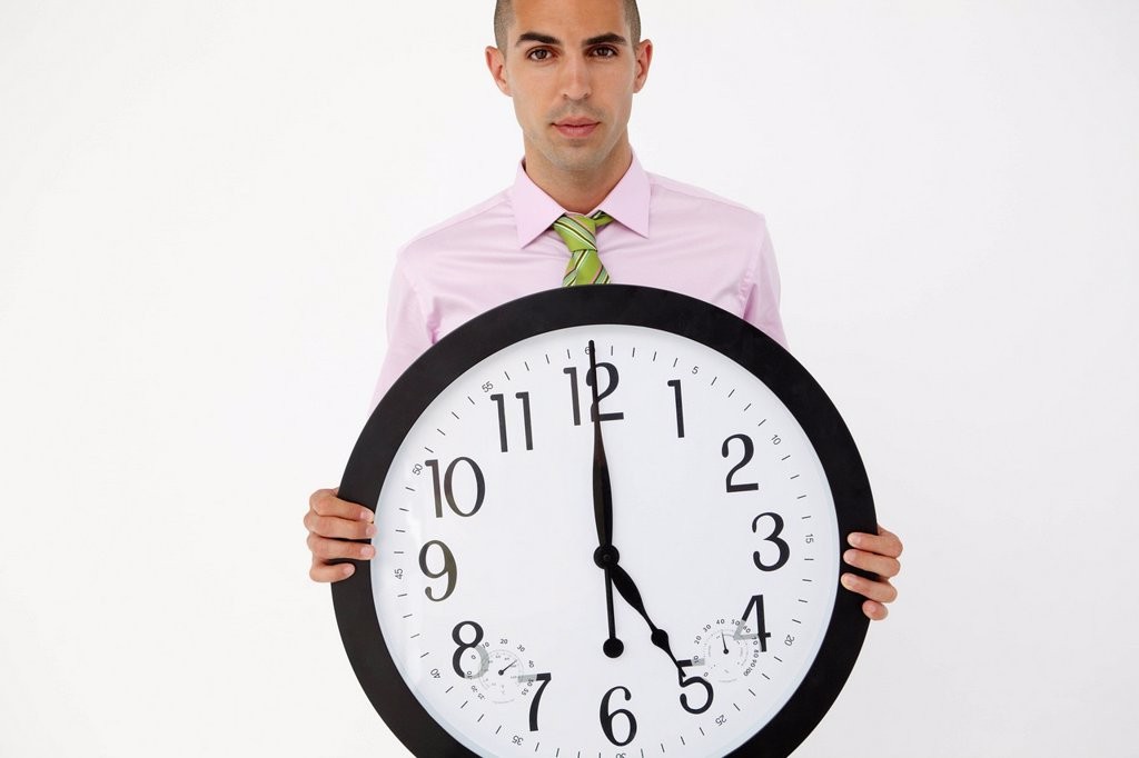 Stock Photo: 1888R-42849 Young businessman with giant clock