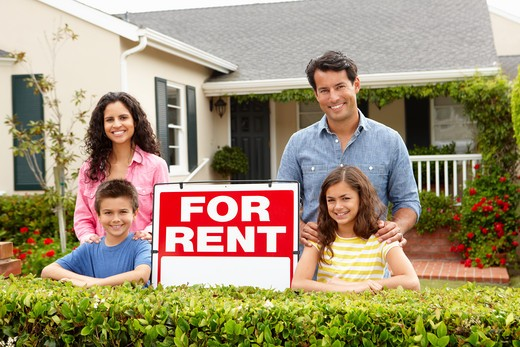 Stock Photo: 1888R-43162 Hispanic family outside home for rent