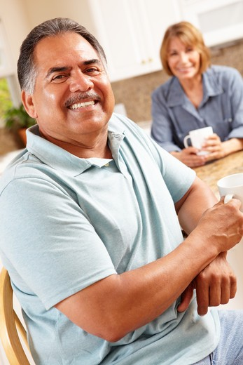 Senior couple relaxing in kitchen : Stock Photo