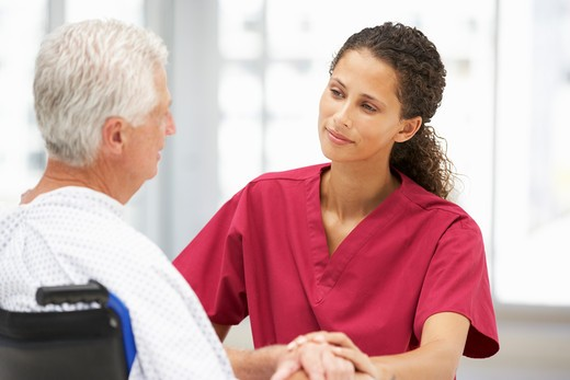 Stock Photo: 1888R-43330 Senior patient with young doctor