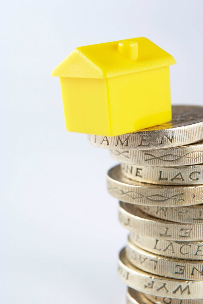 Small model house and coins : Stock Photo