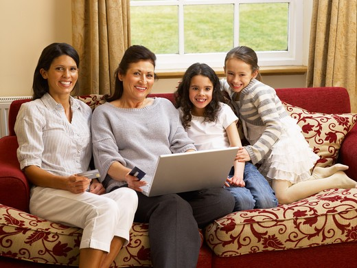 Hispanic family shopping online : Stock Photo