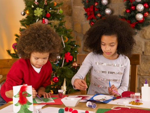 Mixed race children making Christmas cards : Stock Photo