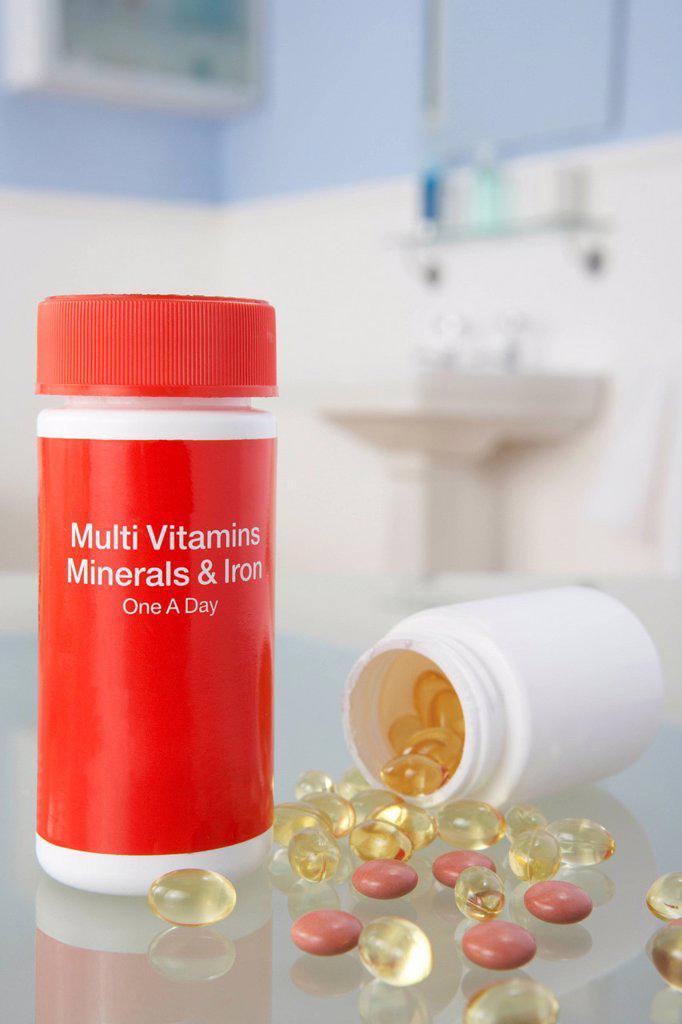 Stock Photo: 1888R-43806 Vitamin pills on bathroom shelf