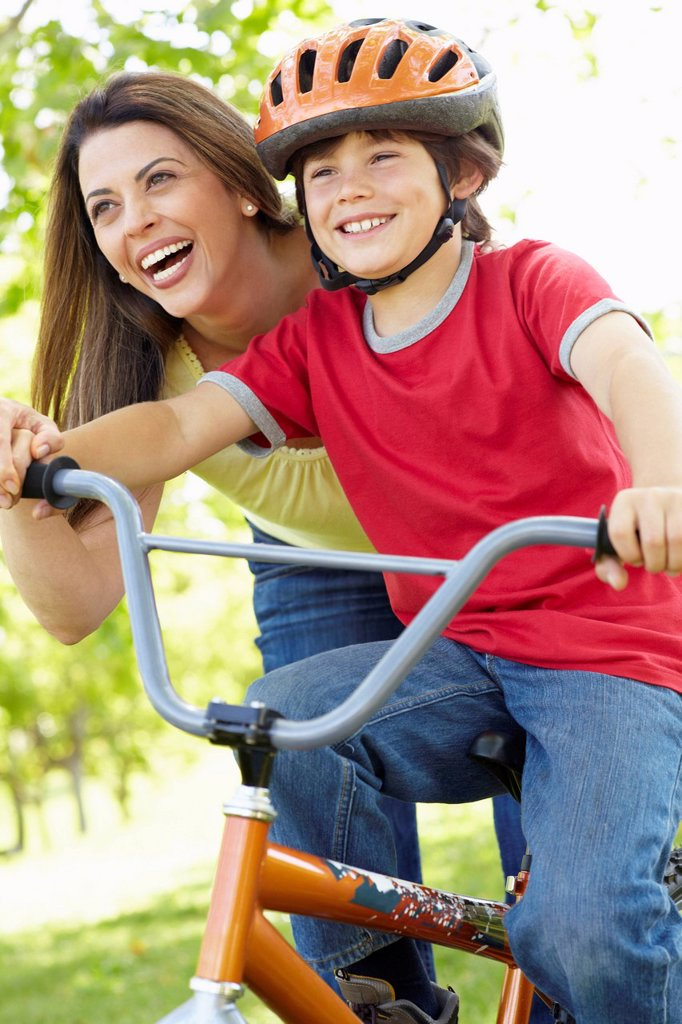 Stock Photo: 1888R-43985 Boy on bike with mother
