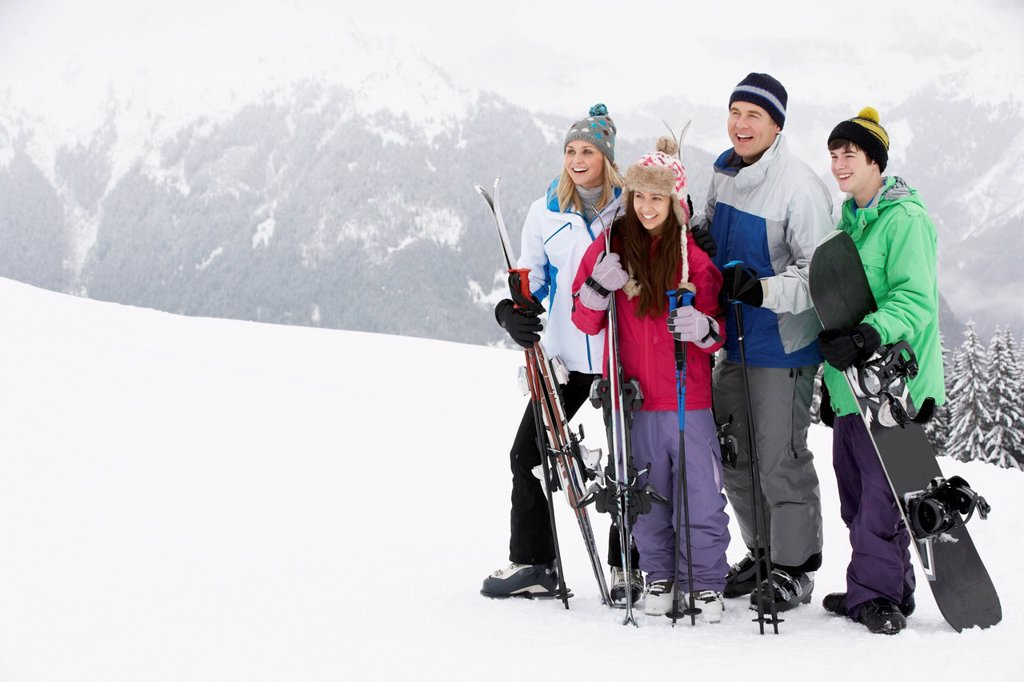Stock Photo: 1888R-44628 Family On Ski Holiday In Mountains