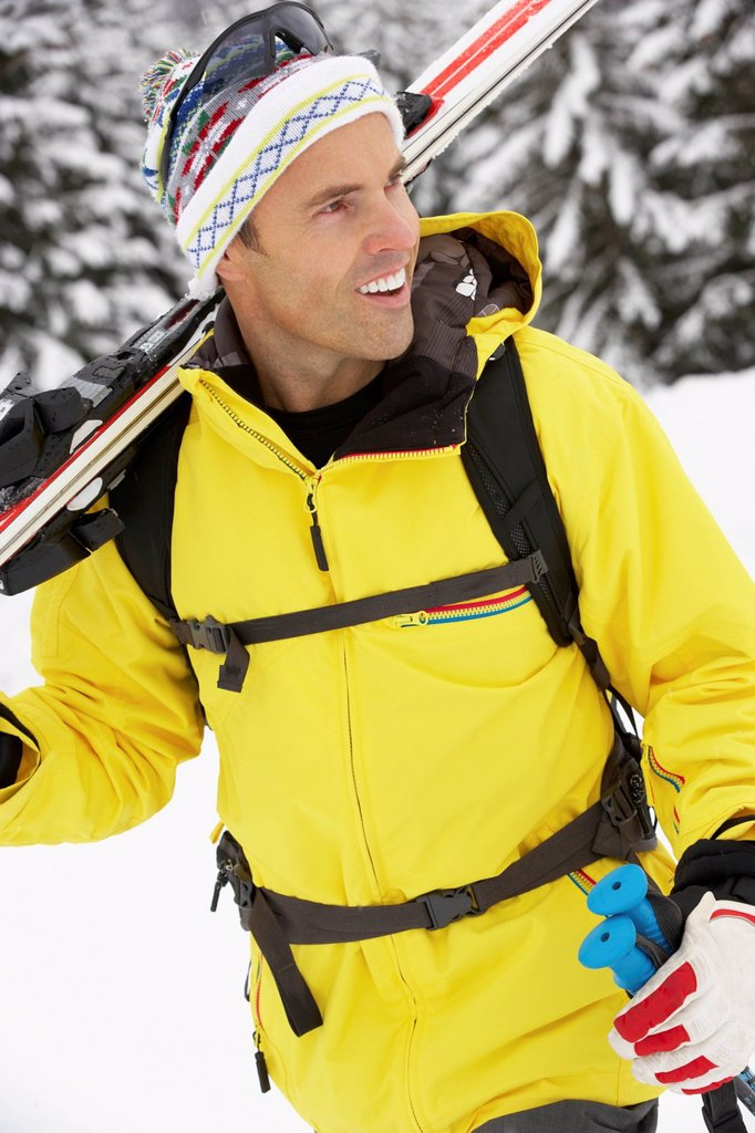 Stock Photo: 1888R-44638 Middle Aged Man On Ski Holiday In Mountains