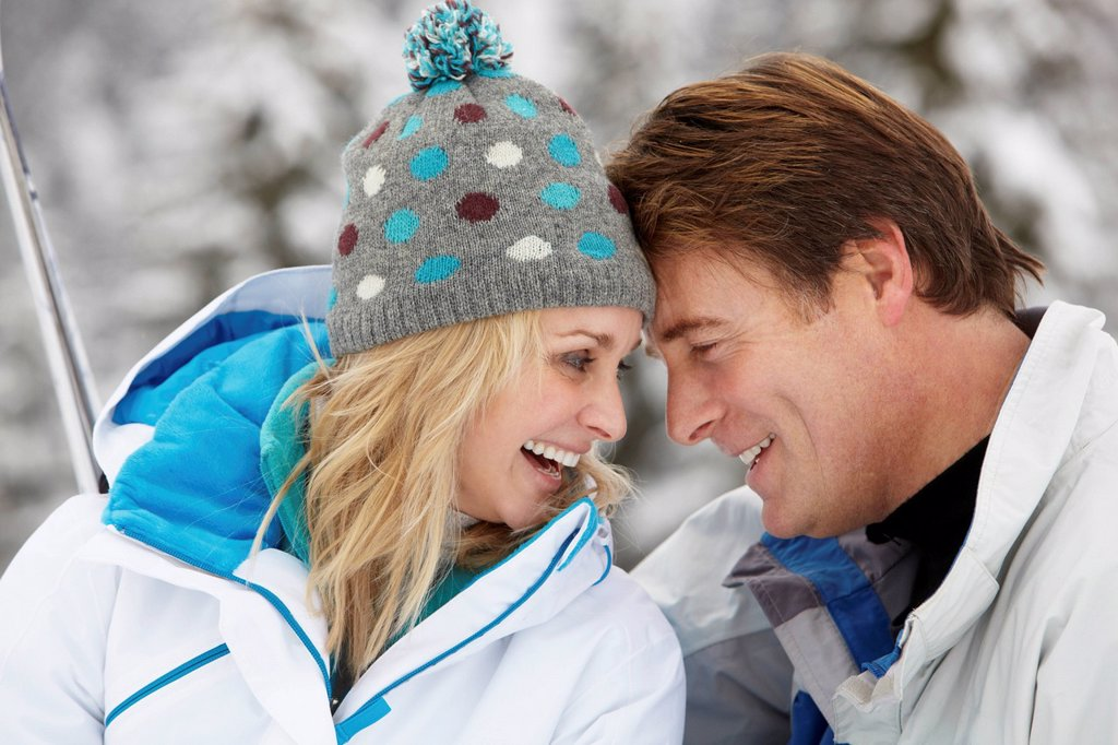 Stock Photo: 1888R-44759 Middle Aged Couple On Ski Holiday In Mountains