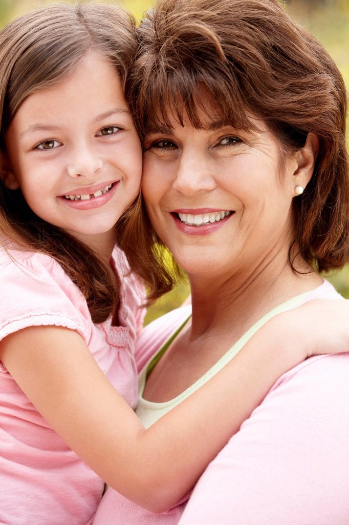 Stock Photo: 1888R-44844 Hispanic grandmother and granddaughter