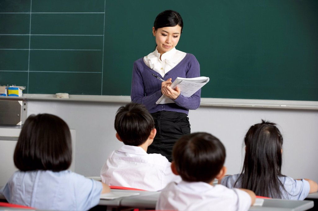 Stock Photo: 1888R-45669 Teacher With Students In Chinese School Classroom