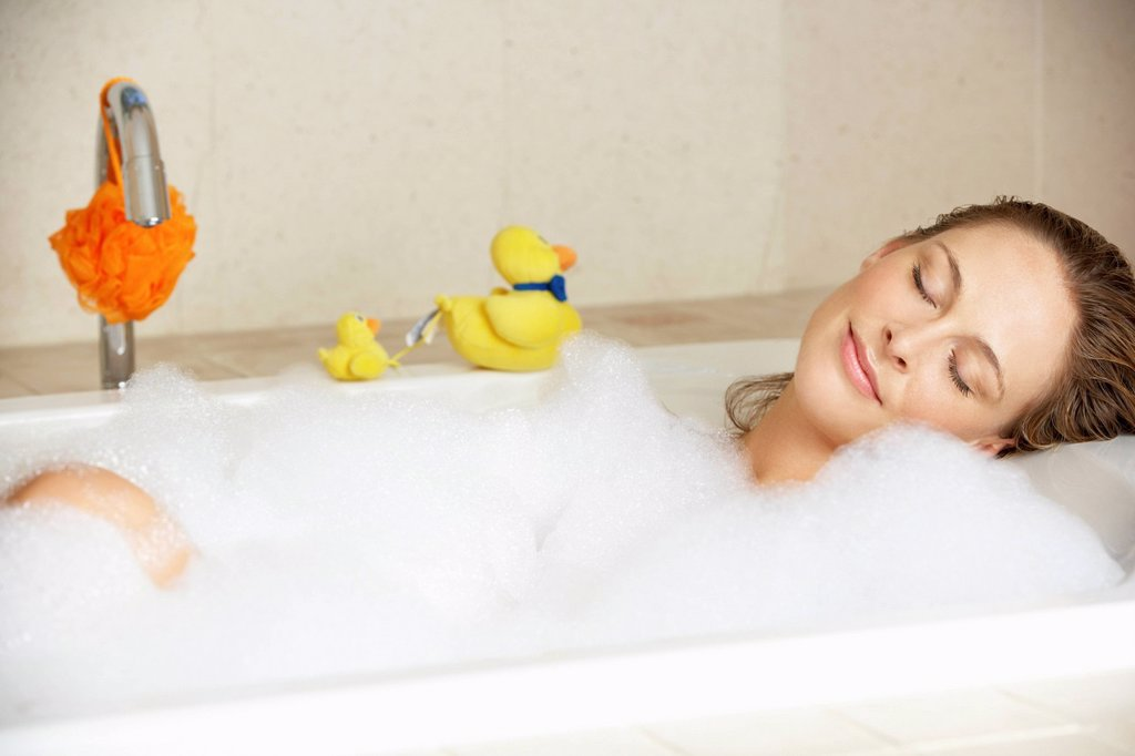 Woman Relaxing In Bubble Filled Bath : Stock Photo