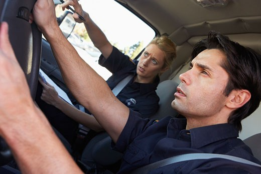 Ambulance driver and colleague on the way to an emergency : Stock Photo