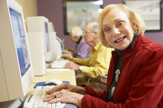 Senior woman using computer : Stock Photo