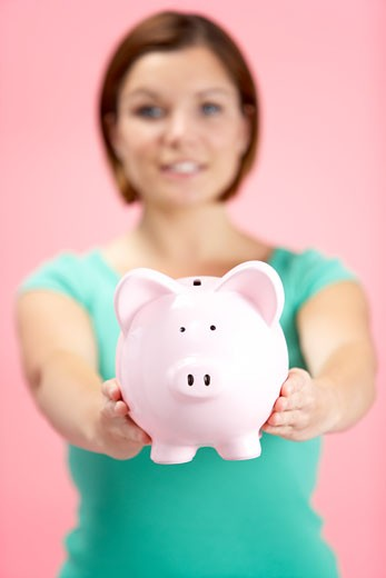 Stock Photo: 1888R-5757 Woman Holding Piggy Bank