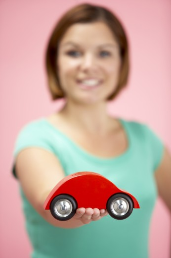 Woman Holding Toy Car : Stock Photo
