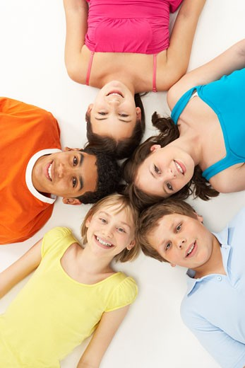 Overhead View Of Five Young Children In Studio : Stock Photo