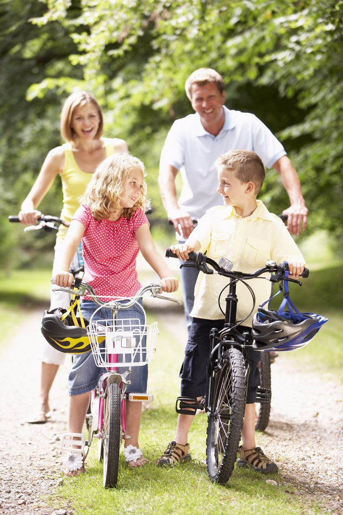 Stock Photo: 1888R-7664 Family riding bikes in countryside