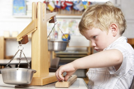 Young Boy Playing at Montessori/Pre-School : Stock Photo