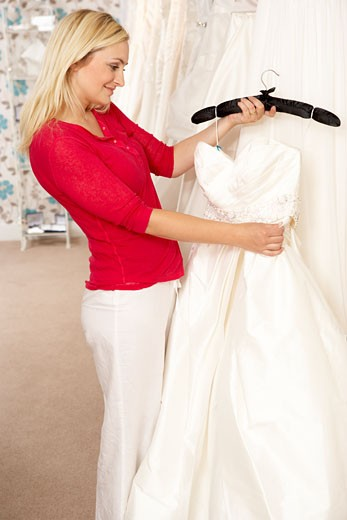 Stock Photo: 1888R-7852 Bride choosing wedding dress