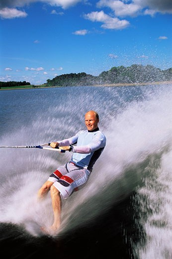 Man waterskiing barefoot : Stock Photo