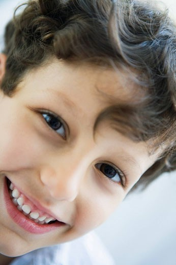 Young boy indoors smiling high key : Stock Photo