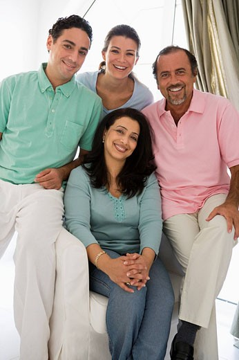 Stock Photo: 1888R-8817 Two couples in living room smiling high key