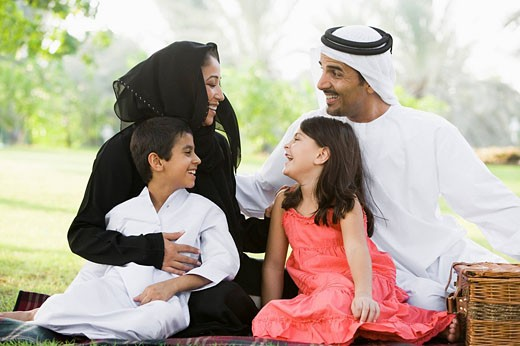 Stock Photo: 1888R-8861 Family outdoors in park having a picnic and smiling selective focus