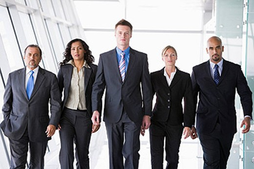Stock Photo: 1888R-9335 Group of co_workers walking in office space high key