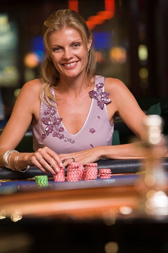 Stock Photo: 1888R-9545 Woman in casino playing roulette smiling selective focus