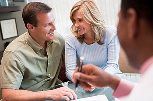 Couple in consultation at IVF clinic selective focus : Stock Photo
