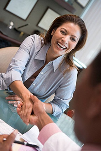 Woman shaking doctor´s hand at IVF clinic selective focus : Stock Photo