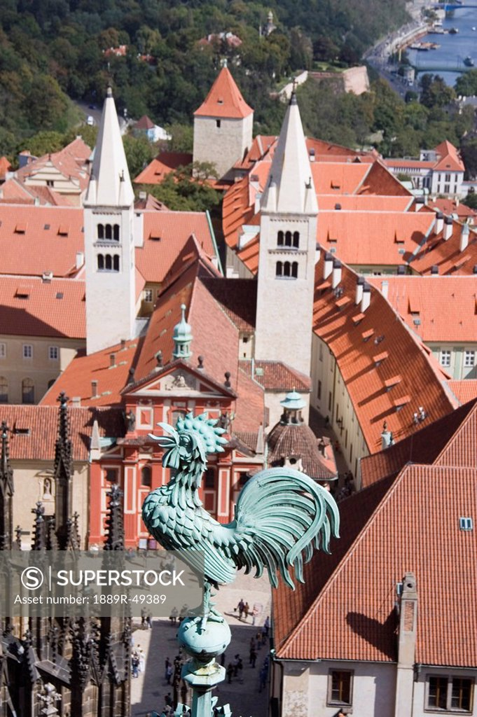 Stock Photo: 1889R-49389 rooster on a church steeple, prague, czech republic