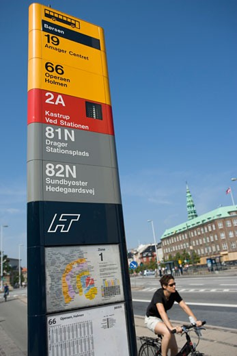 Copenhagen, Denmark; Bus stop with cyclist riding by   : Stock Photo