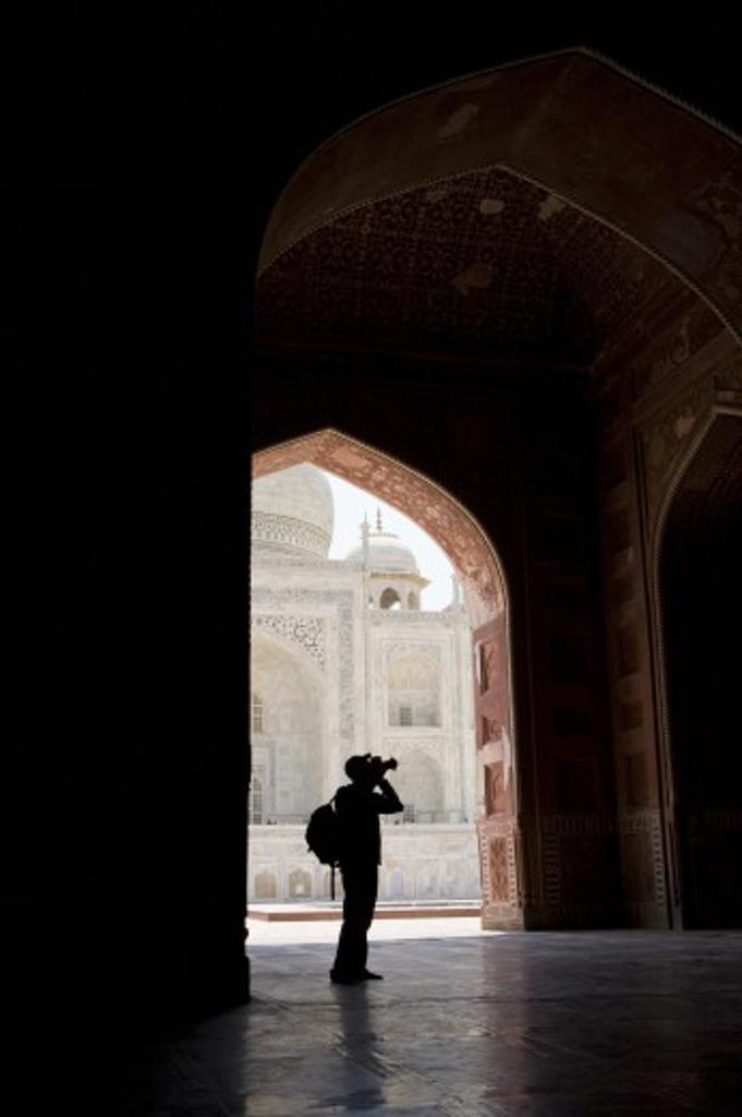 Tourist with camera in Taj Mahal; Taj Mahal, Agra, India : Stock Photo