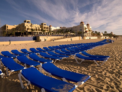 Stock Photo: 1889-40867 Sunloungers on sandy beach; Cabos San Lucas, Los Cabos, Mexico
