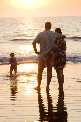Puerto Vallarta, Mexico; Family on beach at sunset : Stock Photo