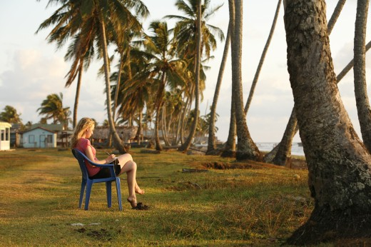 Stock Photo: 1889-42587 Tasbapauni, Nicaragua; Woman writing overlooking beach