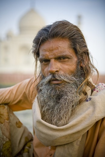Agra, India; Portrait of man in front of Taj Mahal : Stock Photo