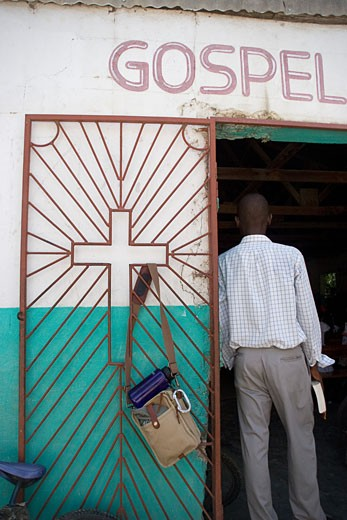 Haiti; Man standing in church doorway : Stock Photo