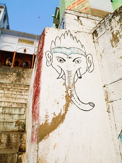 Stock Photo: 1889-43632 The Ganges,Varanasi,India;Mural of elephant on a wall by the ghats which lead to the river